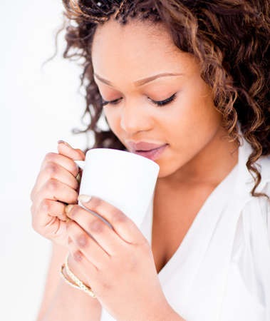 Beautiful woman drinking a cup of coffee photo