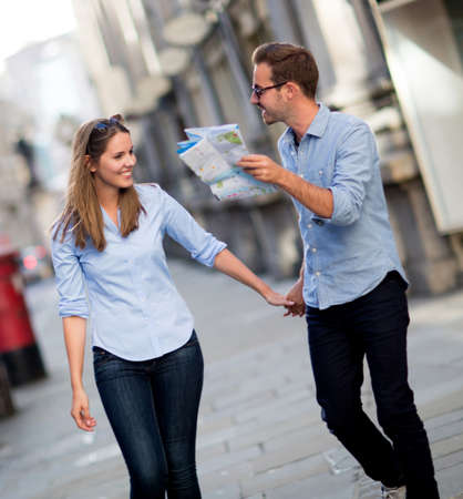 Tourists walking around the city holding a map  photo