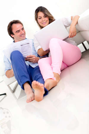 organising: Couple organising their home finances and looking happy  Stock Photo