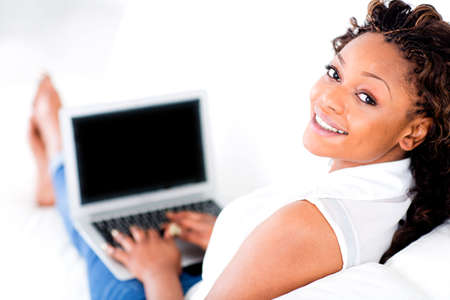 afro hairdo: Black woman working on a laptop from home