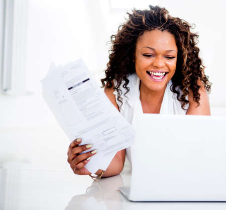 Woman paying her bills at home on her laptop  Stock Photo - 15467928