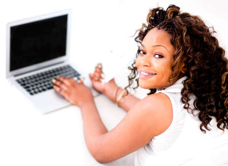 Woman working on a laptop looking happy  Stock Photo - 15467932