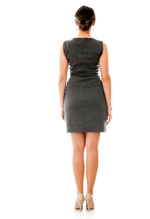 woman standing back: Back of a business woman standing isolated over a white background  Stock Photo
