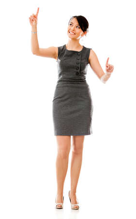 Business woman touching an imaginary screen - isolated over a white background 