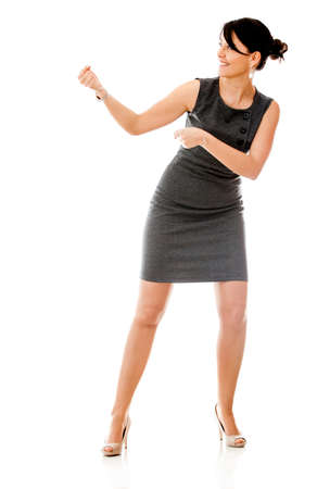Business woman pulling an imaginary rope - isolated over white  photo