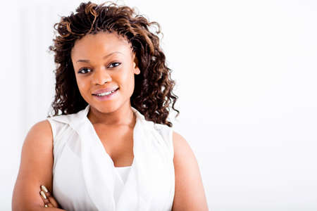 Confident black woman with arms crossed smiling  Stock Photo - 15560666
