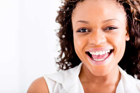 Portrait of a happy African American woman laughing  Stock Photo - 15560656