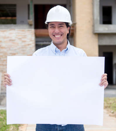 Architect holding banner at a construction site  Stock Photo - 15574610