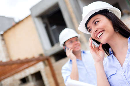 Engineers talking on the phone at a construction site  photo