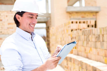 civil engineer: Civil engineer working with a tablet computer