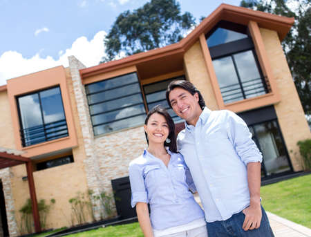 Happy couple standing outside their beautiful house  Stock Photo - 15581108