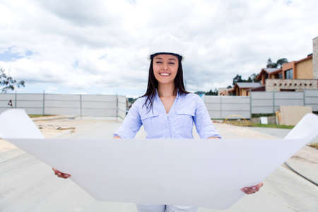 Female civil engineer looking at a house blueprints  Stock Photo - 15652502