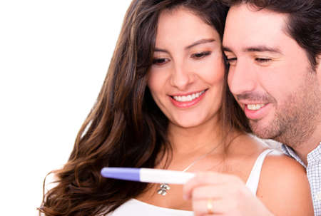 paternity: Romantic couple taking a pregnancy test - isolated over a white background