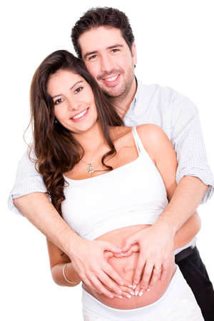 Pregnant couple in love - isolated over a white background  photo