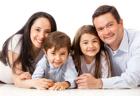 latinos: Family lying on the floor together - isolated over white  Stock Photo