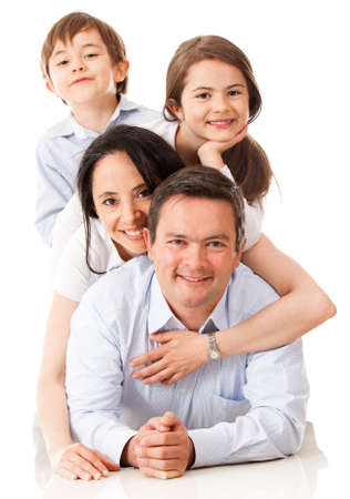 latin girls: Loving family together looking very happy - isolated over white