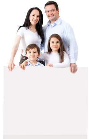 latinos: Happy family with a banner - isolated over a white background