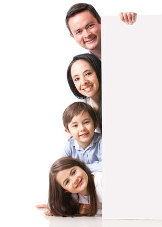 banner ads: Family with a banner smiling - isolated over a white background  Stock Photo