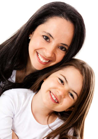 Happy mother and daughter smiling - isolated over a white background  photo