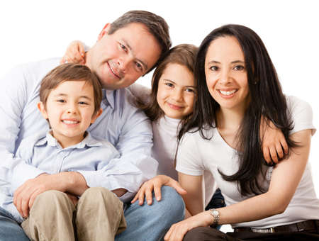 family relationships: Happy family smiling together - isolated over a white background  Stock Photo