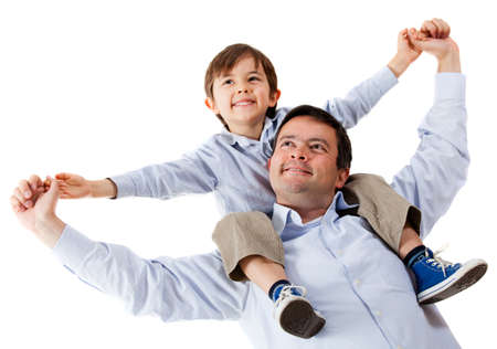 shoulder ride: Father carrying his son on shoulders - isolated over a white background