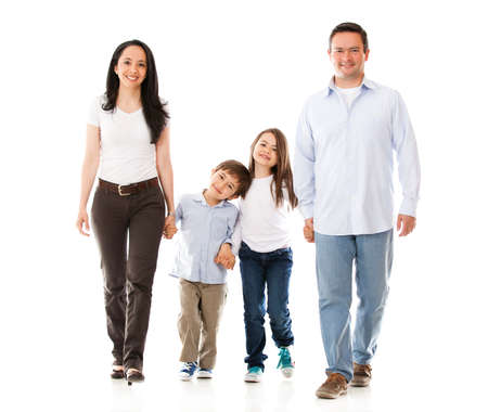 Happy family walking - isolated over a white background  photo