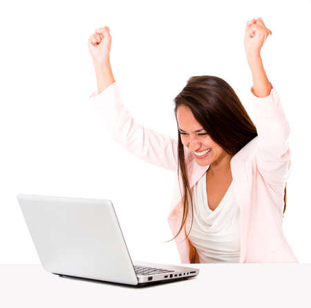 Business woman celebrating her online success - isolated over white  photo
