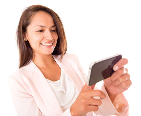 Woman using apps on her cell phone - isolated over a white background  photo