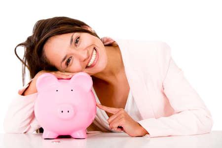 coinbank: Mujer con sus ahorros en una hucha - aislados en blanco