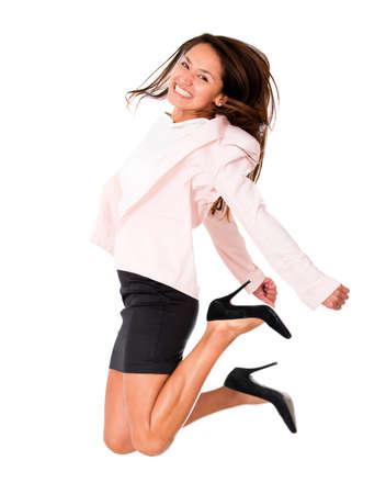 springende mensen: Succesvolle zakenvrouw springen - geà ¯ soleerd over een witte achtergrond Stockfoto
