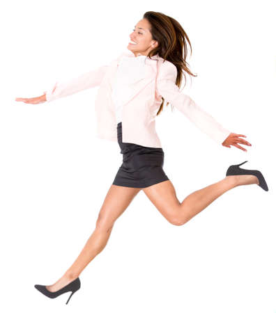 gaps: Business woman taking a big step - isolated over a white background