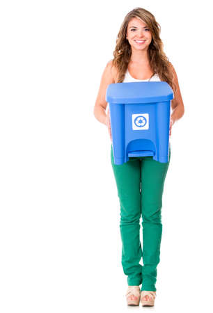 Woman holding a recycling trash can - isolated over a white background  photo