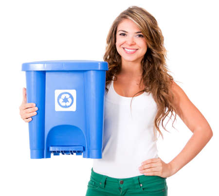 Woman holding a recycle bin - isolated over a white background  photo
