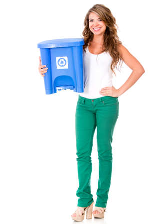 Woman holding a recycling bin - isolated over a white background  photo