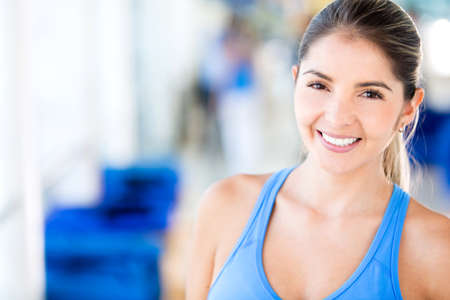 gym clothes: Woman at the gym wearing sports clothes
