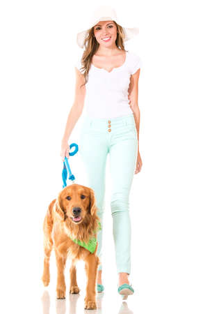 Summer woman walking her dog - isolated over a white background  photo