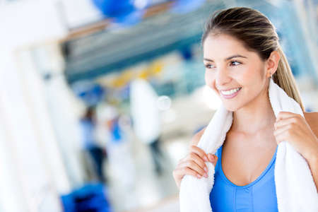 woman in towel: Gym woman holding a towel looking beautiful