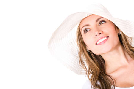 Beautiful woman on vacations wearing a sun hat - isolated over white  photo