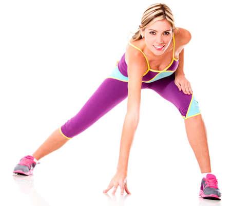 atletisch: Athletic vrouw te oefenen - geïsoleerd over een witte achtergrond