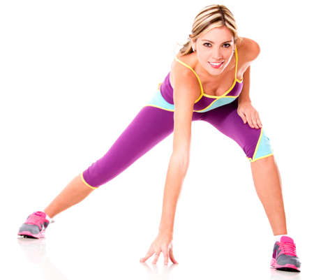 skinny: Mujer atl�tica ejercicio - aislado sobre un fondo blanco Foto de archivo