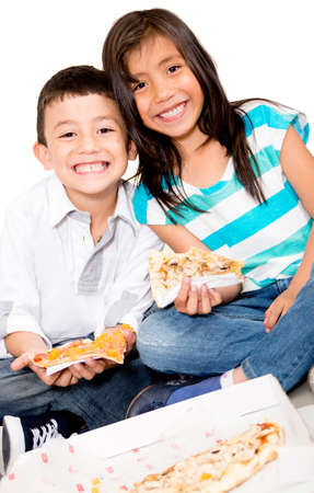 over eating: Happy kids eating pizza - isolated over a white background