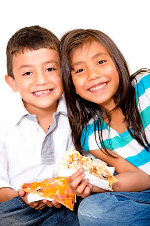 Happy children eating pizza - isolated over a white background  photo