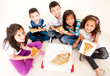 slice of pizza: Happy group of kids eating pizza and smiling
