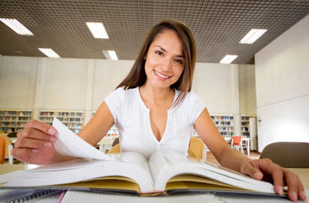 Woman at the library reading a book  Stock Photo - 16409414