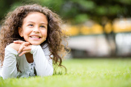 latin: Beautiful girl at the park looking very happy  Stock Photo