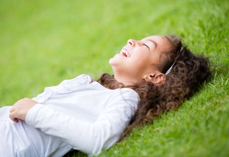 Cute little girl having fun outdoors and laughing  Stock Photo - 16454799