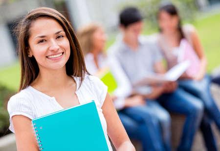 hispanic student: Beautiful female student at the university looking happy  Stock Photo