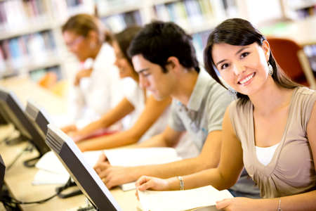 Group of people researching at the library on computers  Stock Photo - 16587238