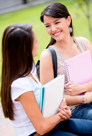 Happy female students talking at the university  Stock Photo - 16586947
