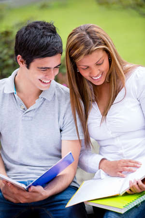 Couple of students at the university talking and looking happy  Stock Photo - 16586880